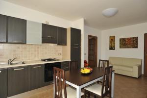 A kitchen or kitchenette at KaRol Casa Vacanze