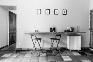 Cuisine ou kitchenette dans l'établissement La Bastane