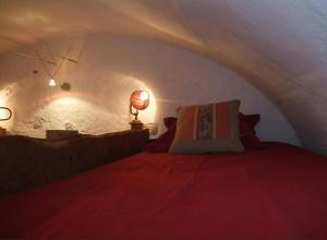 A bed or beds in a room at Le Domaine du Grand Cellier Gîtes Appartement en Savoie