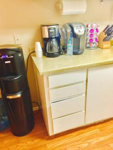 Coffee and tea-making facilities at Strip View Two-Bedroom Home