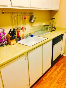 A kitchen or kitchenette at Strip View Two-Bedroom Home