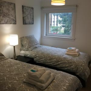 A bed or beds in a room at West Field Apartment