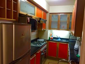 A kitchen or kitchenette at Departamento Puerto Pacifico