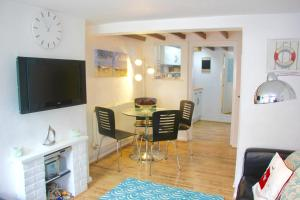 A television and/or entertainment center at Seaside Fisherman Cottage Southwold