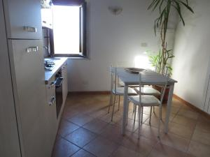 Virtuve vai virtuves aprīkojums naktsmītnē Il Melograno