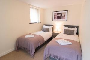A bed or beds in a room at Corn Cottage