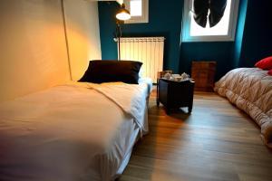 Кровать или кровати в номере Trasteverino 1