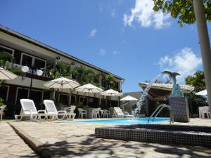 The swimming pool at or near Flat do Golfinho