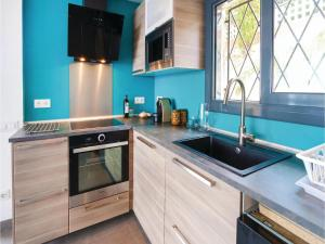 A kitchen or kitchenette at Studio Holiday Home in Pineda de Mar