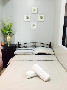 A bed or beds in a room at McKinley hill residences-Stamford Executive