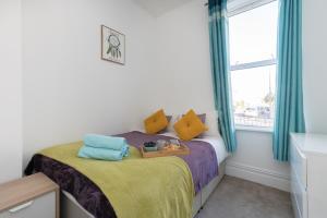Ein Bett oder Betten in einem Zimmer der Unterkunft Flat 1 Marlborough House
