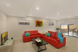 A seating area at Greenacre Villas - Sydney