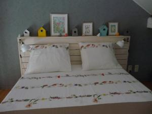 A bed or beds in a room at Autrefois chez Lina