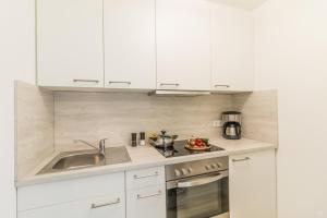 Dapur atau dapur kecil di Ansbachs City Apartment