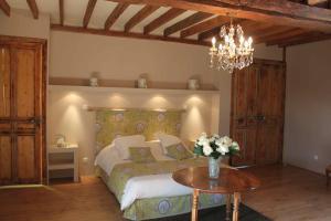 Un ou plusieurs lits dans un hébergement de l'établissement Manoir de l'Oseraie
