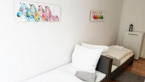 A bed or beds in a room at Cosy Apartment in Berlin, 3 rooms