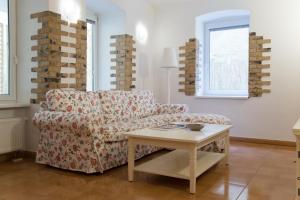 A seating area at Sweet Home At Dunajska St.