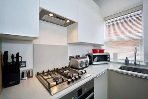 A kitchen or kitchenette at Camberley Luxury Apartments