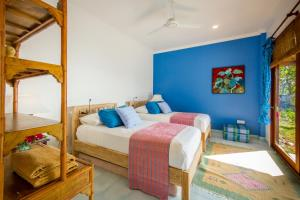 A bed or beds in a room at Aquamarine Beach Villas