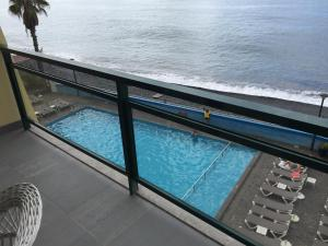 A view of the pool at Atlantic View 2- Apartment with pool and sea view or nearby