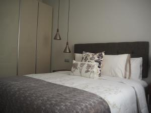 A bed or beds in a room at Apartment Velarde