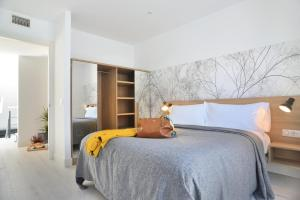 A bed or beds in a room at Aspasios Atocha Apartments