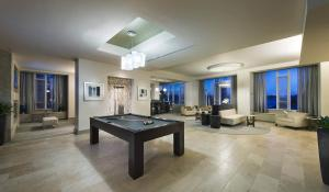 A pool table at Global Luxury Suites at Boston Seaport