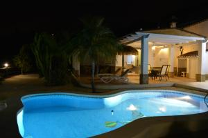 The swimming pool at or near Peperent Villa Buenavista