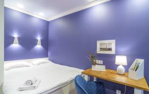 """A bed or beds in a room at """"Indigo"""""""
