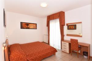 Postel nebo postele na pokoji v ubytování Hotel Villa Olga