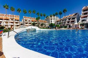 The swimming pool at or near Royal Lux Ocean View Apartament Las Americas