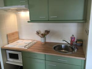 Cuisine ou kitchenette dans l'établissement Le Wim'Heureux Terrasse