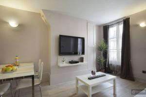 A television and/or entertainment center at Le Marais Apartments