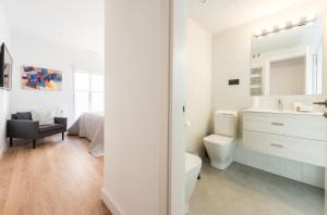 A bathroom at Downtown Boutique - MADFlats Collection