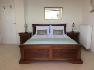 Кровать или кровати в номере Villa Artemis