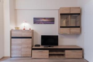 A television and/or entertainment center at Brezoianu Street Studio