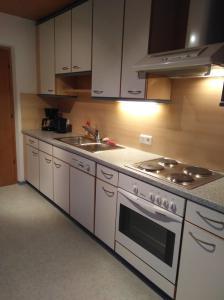 A kitchen or kitchenette at Haus Filz