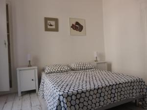 Un ou plusieurs lits dans un hébergement de l'établissement appartement au coeur de Nice