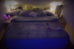 Un ou plusieurs lits dans un hébergement de l'établissement JnSpa21