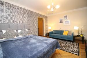 A bed or beds in a room at Tallinn City Apartments - Town Hall Square