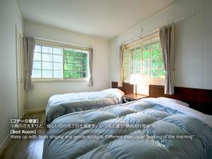 A bed or beds in a room at Resort Villa Takayama