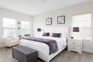 Un ou plusieurs lits dans un hébergement de l'établissement 1037 Reunion Resort 5 Bedroom Villa