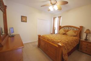Un ou plusieurs lits dans un hébergement de l'établissement 8539 Emerald Island 6 Bedroom Villa