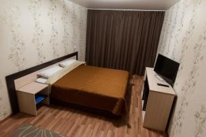 Кровать или кровати в номере «Апартаменты на пр-те Науки 15»
