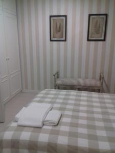 A bed or beds in a room at El Hogar del Prado