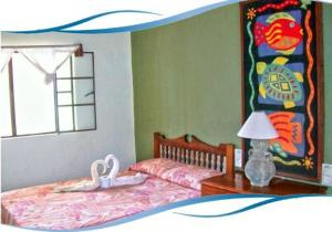 A bed or beds in a room at Bungalows La Playa