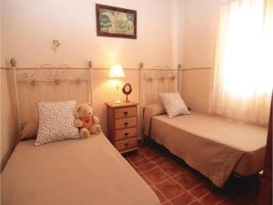 A bed or beds in a room at Three-Bedroom Holiday Home in Torrox