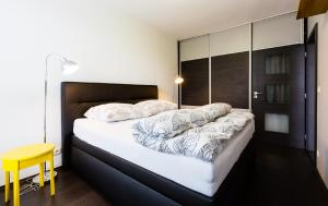 A bed or beds in a room at JM Apartments Viktoria Nivy - free garage parking