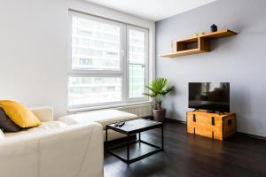 A seating area at JM Apartments Viktoria Nivy - free garage parking