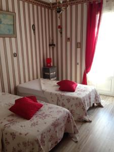 Un ou plusieurs lits dans un hébergement de l'établissement Domaine de Montjouvin